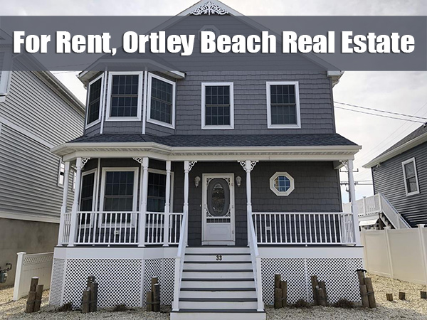 For Rent, Orley Beach Real Estate in white font on banner at top over picture of gray home with porch