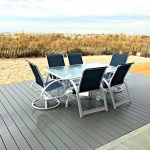 Picture of patio set on gray patio right off beach for condominium that is able to rented for vacations in Ortley Beach