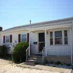 Ortley Beach vacation rental. White, ranch style, Bay-side home on the water with red shutters