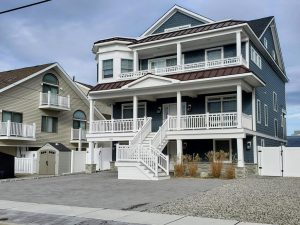 Seaside Park rental picture of Jelly Sue; a blue home with white porch and deck railings