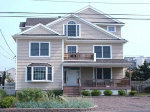 Picture of the home Summerwind, a Seaside Park rental; a tan home with a stone driveway
